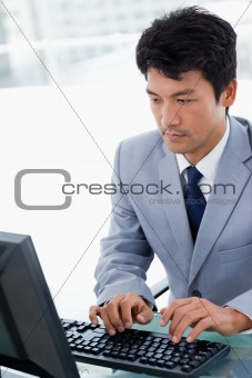 Portrait of a serious manager using a computer