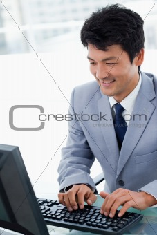 Portrait of a manager using a computer