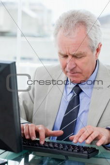 Portrait of a senior manager using a computer