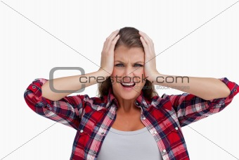 Irritated woman with the hands on her head