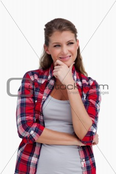 Portrait of a young woman thinking