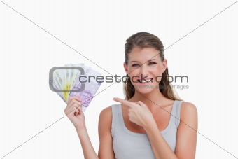Woman pointing at bank notes