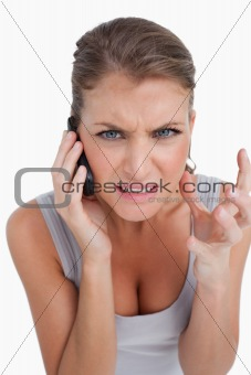 Portrait of an angry woman making a phone call