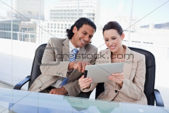 Happy business team using a tablet computer