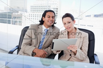 Beautiful business team using a tablet computer
