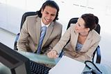 Joyful business team using a computer