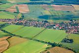 Aerial view of countryside with village and farmland