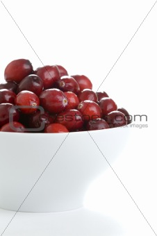 fresh cranberries in a white bowl
