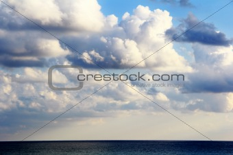 Scenery with sea and fluffy sky