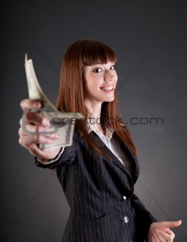 Smiling business woman with dollars