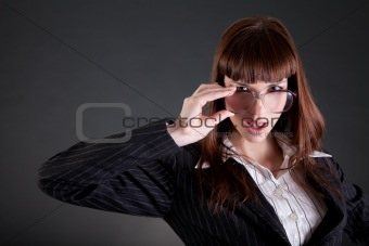 Businesswoman in old fashioned glasses