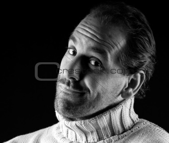 Adult man portrait cheerful wink expression on black and white