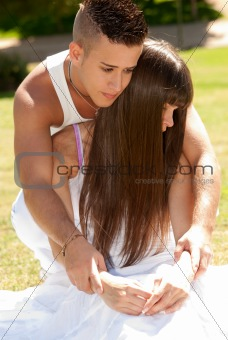 young couple happy embrace on grass white clothes, love relationship