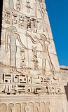 Egyptian hieroglyphic carvings on a temple wall