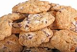Mound of chocolate chip cookies against a white background