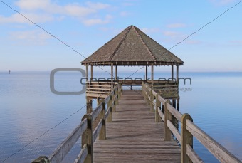 Gazebo and dock over calm sound waters