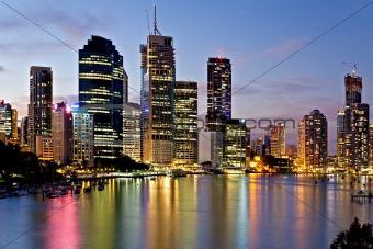Brisbane city reflected in the river at sunset