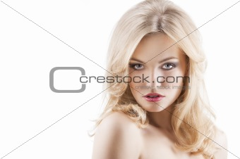 sensual pretty woman with flying hair, she looks in to the lens