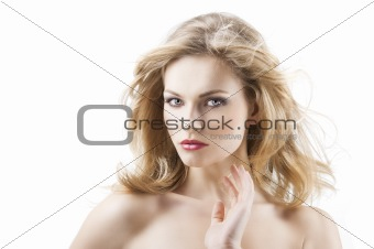 sensual pretty woman with flying hair, with right hand near the