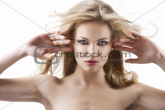 sensual pretty woman with flying hair, her both hands are open n