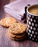 Cinnamon cookies with nuts and mug of delicious coffee