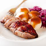 Roast duck breast with potato dumplings and red cabbage