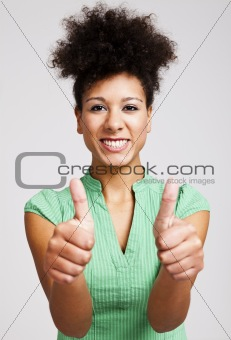 Beautiful woman with thumbs up