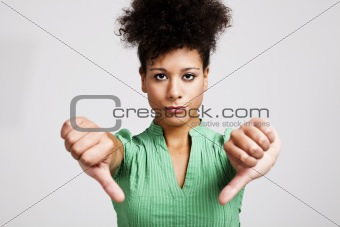 Beautiful woman with thumbs down