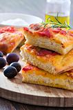Focaccia with tomato and black olives.
