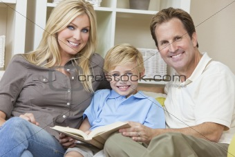 Happy Family Sitting on Sofa Reading A  Book