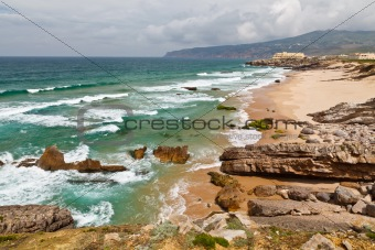 Beach on Atlantic Ocean Coast in Stormy weather near Lisbon, Portugal