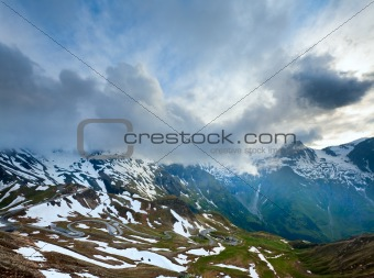 Evening cloudy Alps summer view