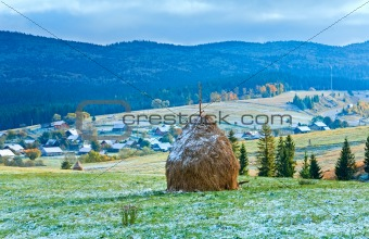 First winter snow and autumn mountain village