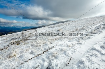 First winter snow on autumn  mountain plateau