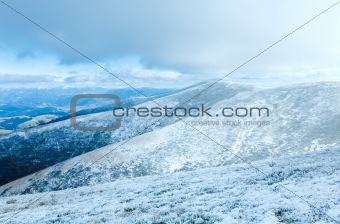 First winter snow on autumn  mountain plateau