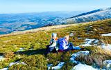 Children rest on autumn  mountain plateau with first winter snow