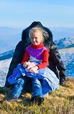 Family on autumn  mountain plateau.