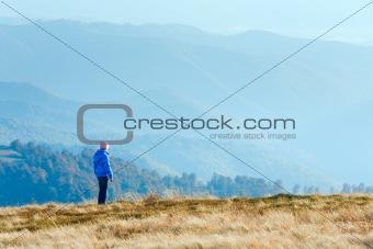 Small girl on autumn  mountain plateau