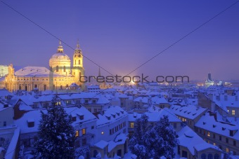 prague - st. nicolas church and rooftops of mala strana in winter