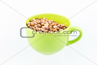 Beans in green bowl isolated on white