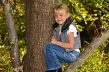 smiling girl in tree