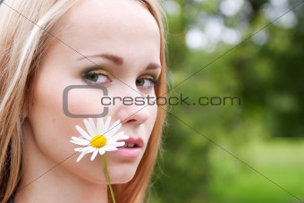 portrait of a girl with chamomile