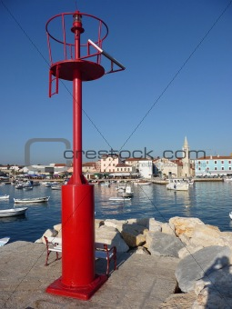 Old adriatic Town of Fazana, behind red beacon