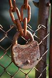 Rusty padlock, iron chain, net