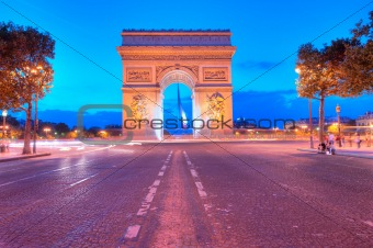 Evening traffic on Champs-Elysees in front of Arc de Triomphe (P