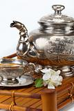 green tea in the cup, teapot, flowers