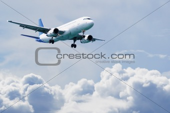 Passenger airliner flies above the clouds