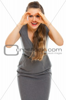 Business woman looking through binoculars shaped hands