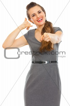 Business woman showing call me gesture