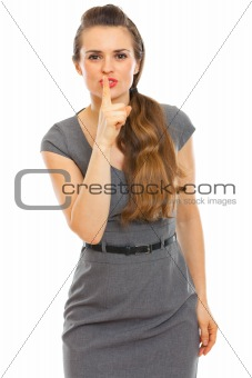 Business woman showing shhh... gesture